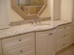 interior-bathroom-white-stained-wooden-bathroom-vanity-cabinet-with-white-half-bull-nose-countertop-and-single-round-undermount-sink-granite-bathroom-vanity-countertops-840x630